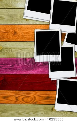 Pile of Blank Photos on Wood Background