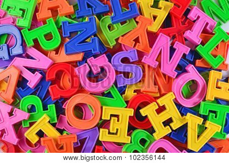 Colorful Plastic Alphabet Letters As Background