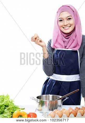 Young Woman Preparing Making A Meal With Ingredients On The Table