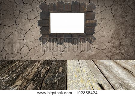 isolated wooden frame on grunge wall and wood floor.