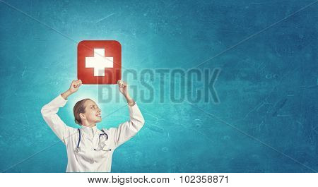 Close up of doctor hands with medicine cross sign