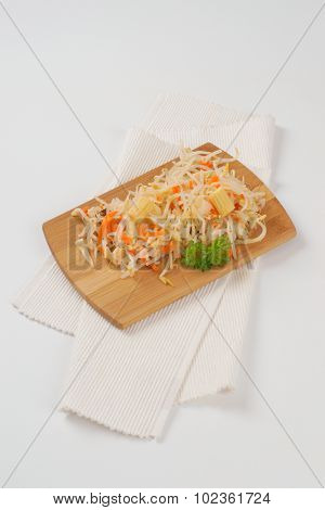 carrot and bean sprouts salad on wooden cutting board and white place mat