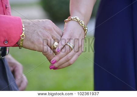 picture of hands of a bride and grrom. love theme