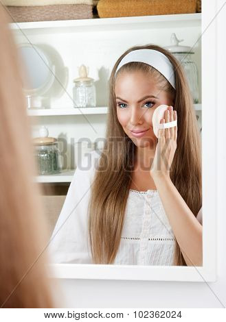 Pretty Woman Cleaning Her Face