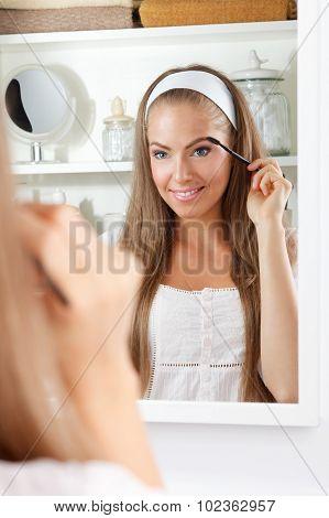 Beauty Woman Brushing Her Eyebrow