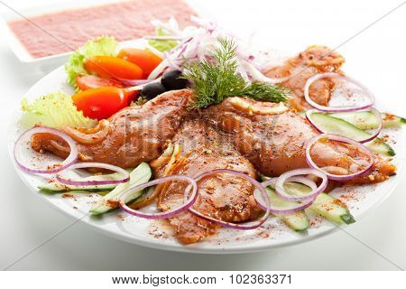Marinated Chicken Breast with Onions and Vegetables