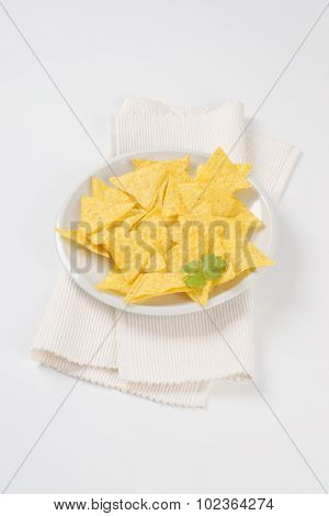 plate of tortilla chips on white place mat