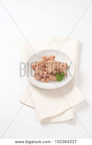 plate of tuna chunks on white place mat