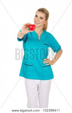 Smiling nurse or female doctor with heart.