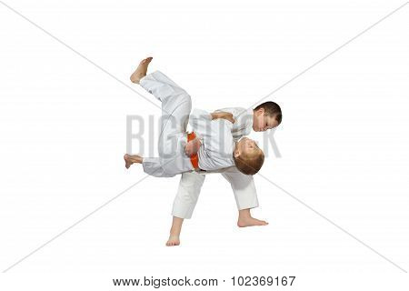 Boys are training judo throw on a white background