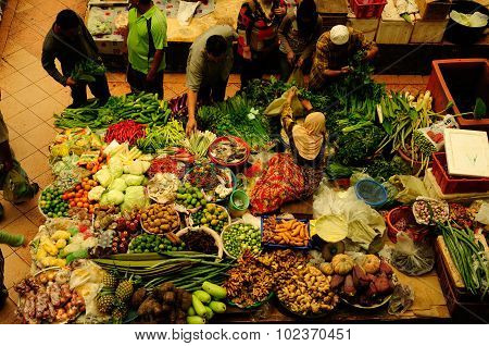 Vegetable and wet market. Muslim woman selling fresh vegetables at Siti Khadijah Market market in Ko