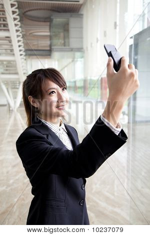 businesswoman taking picture by camera phone