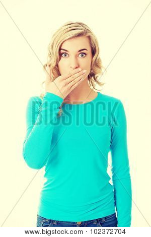 Full length woman covering her mouth.