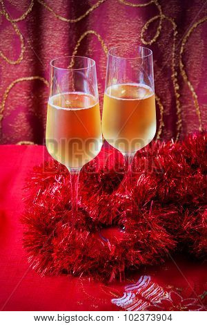 Glasses Of Champagne And Red Tinsel