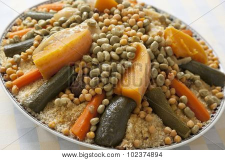 Festive Moroccan couscous with broad beans on a dish