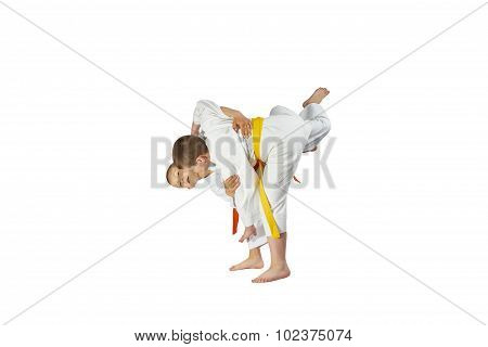 Boys are training throws on a white background