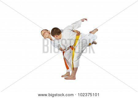 On a white background athletes are doing judo throws
