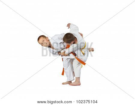 The athletes in judogi are performing throws