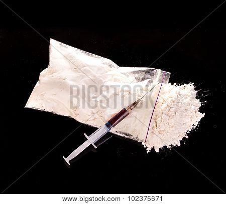 Drug Powder, Drug Syringe Close-up On A Black Background.