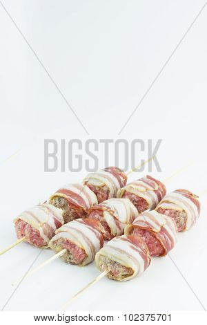 Bacon wrapped meatballs skewers.
