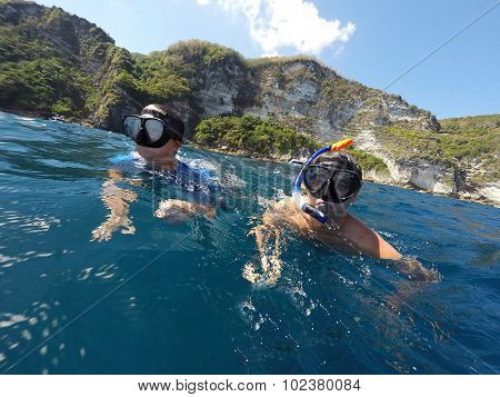 Shoot Of A Young Boy Snorkeling With Father