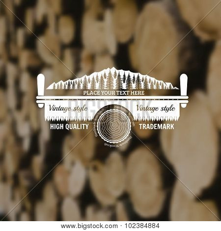 carpenter craft style background with two-man saw forest and log middle on old plank blur photo