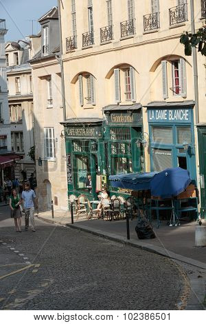 PARIS, FRANCE - SEPTEMBER 8, 2014: Cafés and restaurants at the Montagne Sainte Genevieve street in Paris near Sorbonne and Patheon