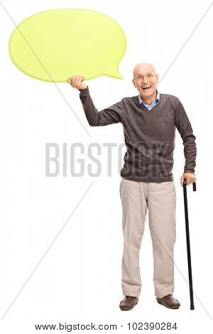 Full length portrait of a senior gentleman with a black cane holding a big yellow speech bubble isolated on white background