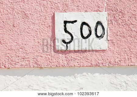 Hand painted street number five hundred