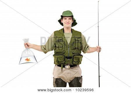 Happy Fisherman Holding A Plastic Bag With Golden Fish