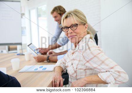 Portrait of senior woman attending business class