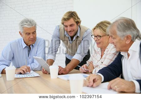 Business instructor with group of senior people