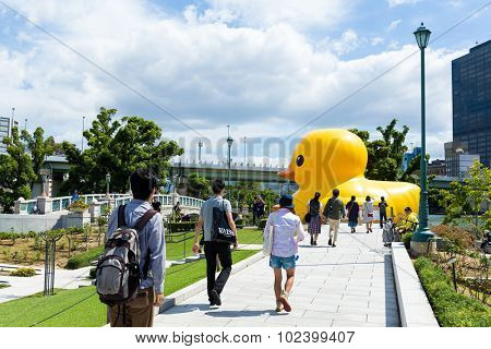 Japan Osaka - September 19: The giant duck in osaka on September 19 2015. :Yellow Duck Sculpture By Florentijn Hofman outside Nakanoshima park