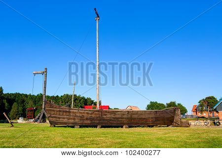 Ancient wooden boat on the grass. Sturmai village, Lithuania