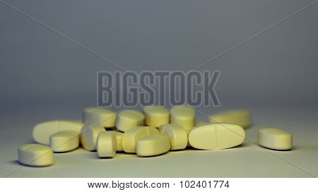 Pills On A White Background. Symbolic Photo For Medicine And Drugs