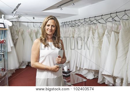 Portrait Of Female Bridal Store Owner With Digital Tablet