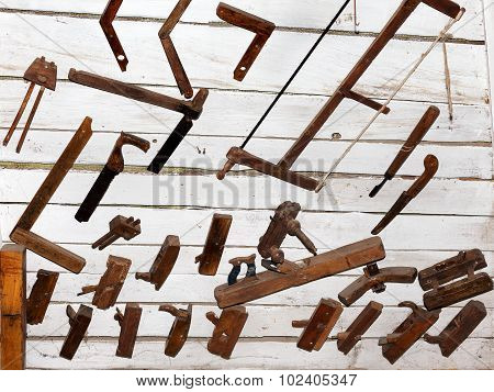 Vintage Carpenter Tools On Wooden Textured Wall