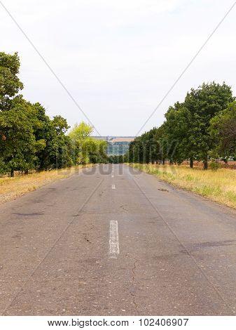 Old Damaged Asphalt Road In Rural Ukraine. Rural Landscape.