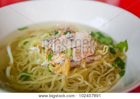 Chinese Egg Noodles With Crab Meat In Hot Soup.