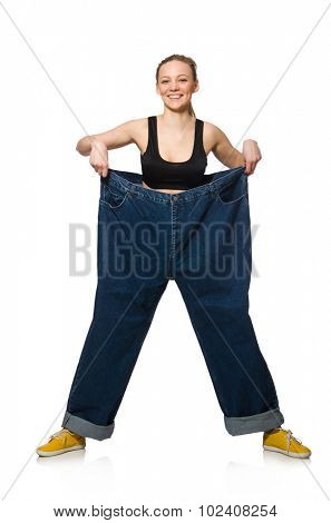 Dieting concept with big jeans on white