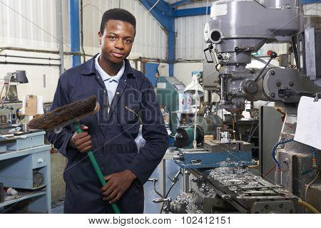 Apprentice In Engineering Factory Sweeping Floor