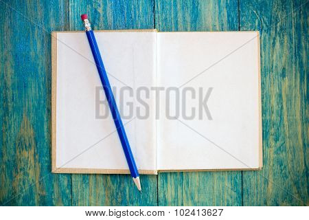 Open Book And Pencil