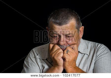 Senior man desperately thinking about life problems