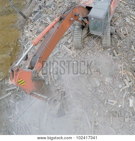 MOSCOW - APR 17, 2015: Excavator moves old building ruins at spring day. Aerial view