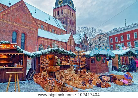 Christmas Market Stall With Straw Basket Souvenirs Displayed For Sale