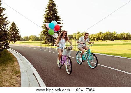 Couple In Love  Riding A Bicycle Race With Balloons