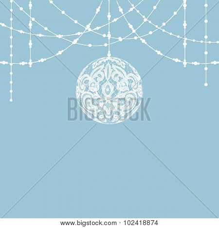 White lace bauble decoration on blue