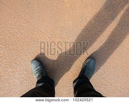 Business Man Look Down To Floor, Full Of Rust.