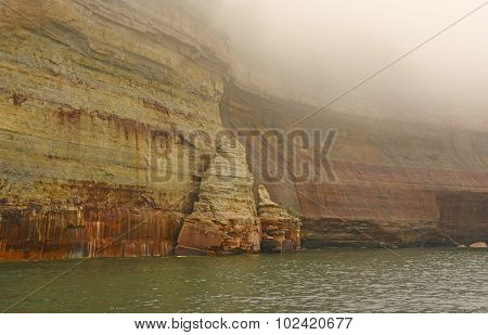 Colorful Cliffs In The Fog