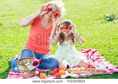 Family having fun while picnicking in the park